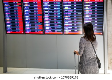 Passenger holding luggage for wait to travel in transtationin Thailand Airport