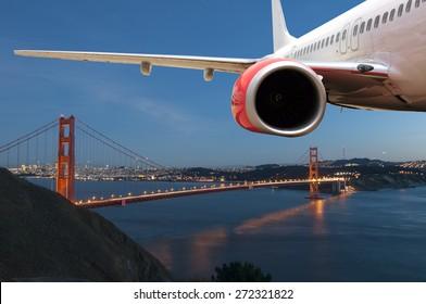 Passenger Jet Plane Flying above the Golden Gate Bridge for travel concept