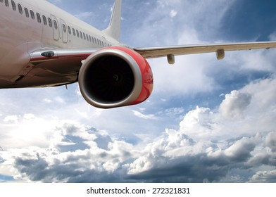 Passenger Jet Plane Flying in the clouds for travel concept