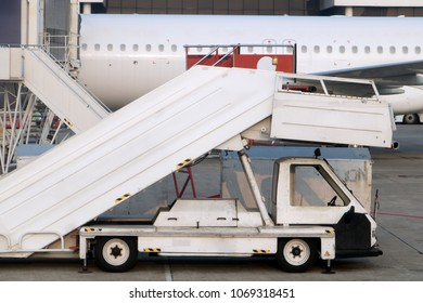 Passenger ladders for boarding passengers in an airplane. Airplane stairs prepared for boarding.