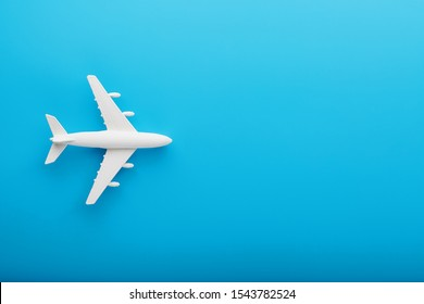 Passenger Model airplane on a blue background. Free space for text.