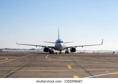 Passenger plane at airport in winter afternoon. plane on airport platform in  winter. Airplane on summer strip in winter