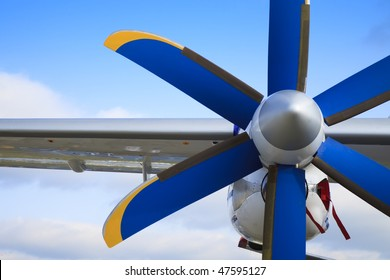 The passenger plane,  blue and yellow propeller