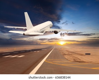 Passenger plane climbs into the sky after take off. Aircraft flies over the airport runaway during the sunset time.