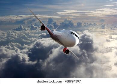 Passenger plane flies high above the clouds