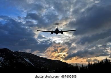 passenger plane flies in juicy clouds to meet the sun