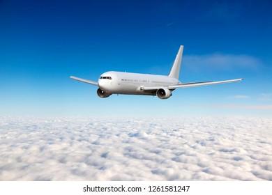 A passenger plane flies in a transparent clear blue sky. Aircraft flies over the clouds.
