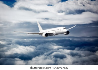 Passenger plane in flight. Aircraft fly high in the sky between the cloud layers. Front view.