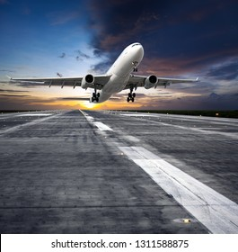 Passenger plane in flight. Aircraft takes off from the airport runway during the sunset. Front view of aircraft.
