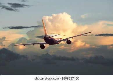 Passenger plane flying in the clouds, air travel concept