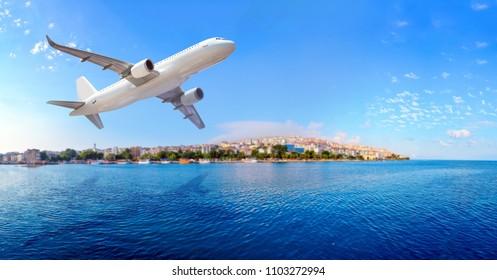 Passenger plane flying over the city
