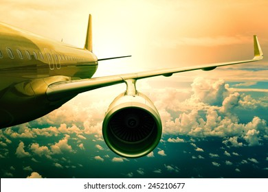 passenger plane flying  over cloud use for  transportation and traveling theme