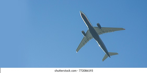 A passenger plane flying in the sky.