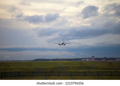 A passenger plane lands on the Pulkovo airport on a cloudy evening. Saint-Petersburg, Russia