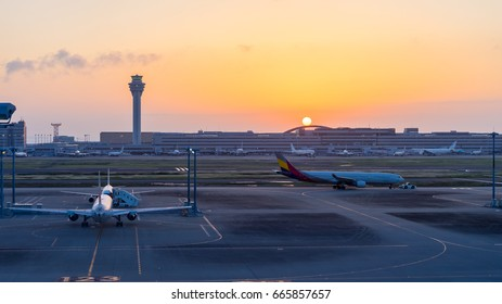 passenger plane  take-off runway from airport at sunrise