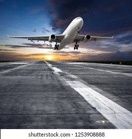 Passenger plane takes off from the airport runway. Front view of aircraft. Sunset time. Square format.