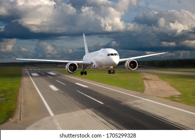 A passenger plane takes off from the airport runway. Background in motion blur.