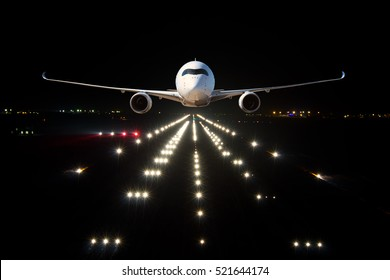 A Passenger Plane Takes Off From The Airport Runway At Night Aircrafr Front View