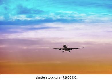 Passenger plane takes off at sunset