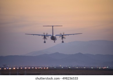The passenger plane which flies in the nightfall sky