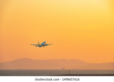The passenger plane which takes off for the sunset sky