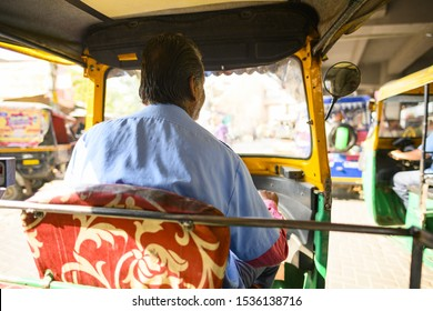 (Passenger point of view) A unidentified driver is riding his auto rickshaw (also known as Tuc Tuc) through the busy streets of the pink city of Jaipur, Rajasthan, India.