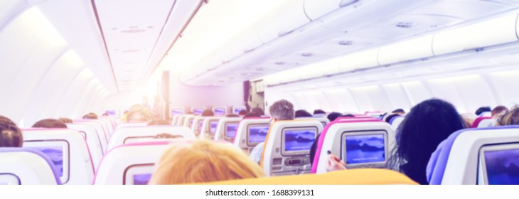 passenger seat, Interior of airplane with passengers sitting. cabin of airplane with passengers on seats waiting to take off. Blurred picture.