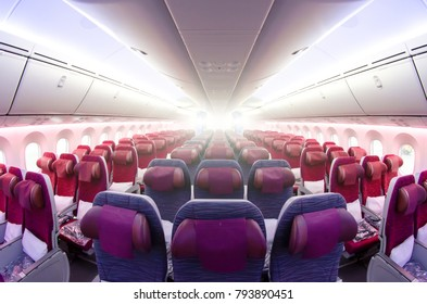 Passenger seat, Interior of airplane with passengers sitting on seats
