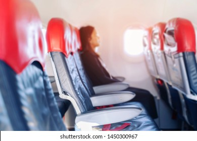 passenger seats, Interior of airplane of Young woman on passenger seat near window in airplane the aisle in background. Travel concept,vintage color