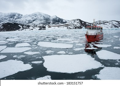 Passenger ship sailing through the icy waters of Qasigiannguit, Greenland.