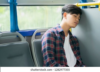 Passenger sleeping inside a public transport while traveling. Tired exhausted taking a nap in public transportation. Falling asleep during a long ride.
