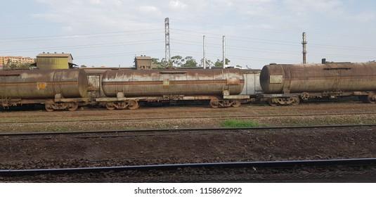 Passenger Train and Abandoned Trains at the Kampala Railway Station in Kampala, Uganda