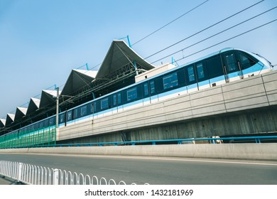 passenger train moving in city,tianjin,china.