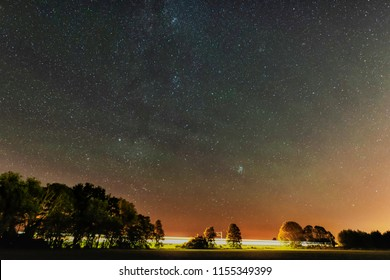 Passenger train at night in cloudless sky with the edge of the Milky Way