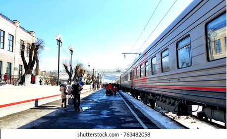 Passenger train stops at the Trans Siberian railway station