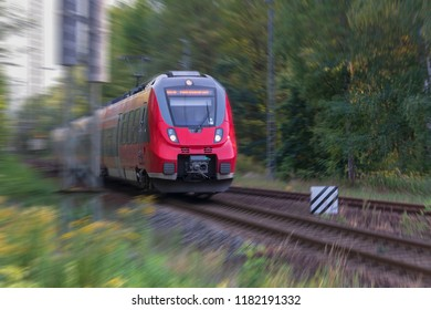 Passenger train travels over a switch