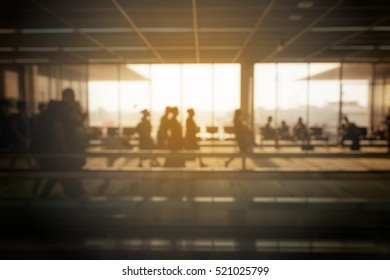 The passenger was traveling on a plane at the airport. Silhouette and blurred background