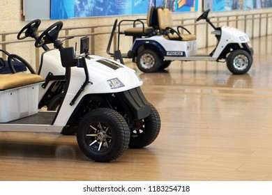 Passenger Utility golf car for Airport. Police golf-Car at the airport
