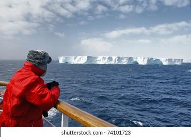 Passenger viewing beautiful iceberg at Antarctica.