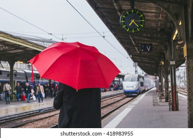 passenger waiting for the train on the platform of railway station