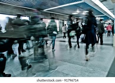 passenger walk at subway station