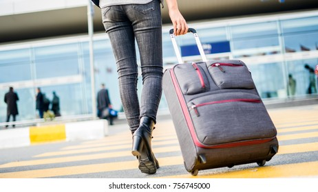 Passenger walking  at the airport with suitcase