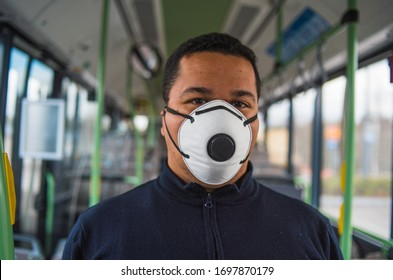 passenger wears mask in bus to protect himself from the coronavirus epidemic is alone in bus. Pandemic coronavirus 2020. Quarantine.Virus concept. Epidemic infection.