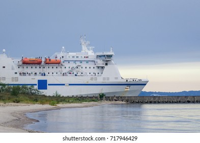 PASSENGER-CAR FERRY - ship sails into the sea from seaport
