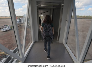 Passengers boarding aircraft along a airbridge or jetway at airport