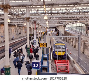 Passengers boarding stationery train at Waverley train station, Edinburgh city centre, Edinburgh, Scotland UK. February 2018
