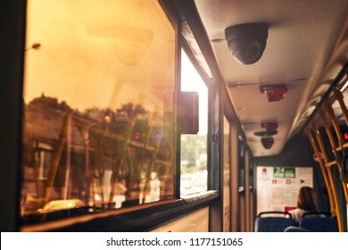 passengers in the bus opened a tinted window in the cabin of the bus that would cool the outside air inside