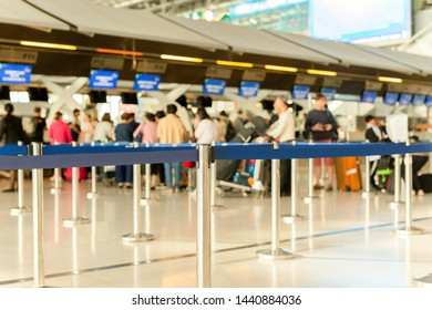 Passengers check-in line at the airport on vacation.