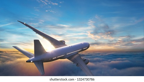 Passengers commercial airplane flying above clouds in sunset light. Concept of fast travel, holidays and business.