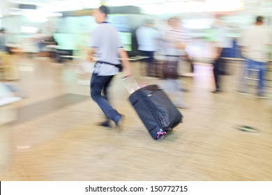 passengers dragged baggage walking on the way at airport for check in